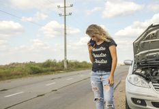 The girl calls for technical, assistance on the road. The girl calls for technical assistance on the road Royalty Free Stock Images