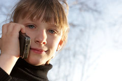 Girl calls to home Stock Image