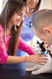Girl calm down her sick cat in veterinary clinic. Lovely girl calm down her sick cat in veterinary clinic royalty free stock images