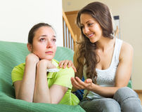 Girl calms upset friend Royalty Free Stock Photo