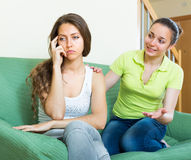 Girl calms upset friend Stock Photo