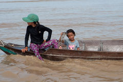 Girl of Cambodia with small crocodile Stock Images