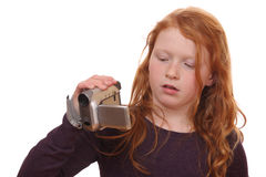 Girl with camcorder Royalty Free Stock Image