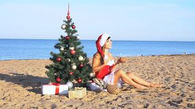 Girl on beach resort in Christmas clothes for the new year stock video footage