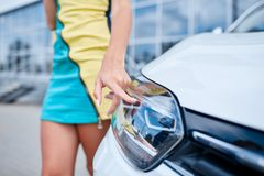A young girl chooses a new car for herself. Buying a new car. Royalty Free Stock Photos