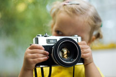 Girl with camera Stock Photos