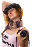 Girl with a camera. Pretty red-haired girl with a camera Royalty Free Stock Images