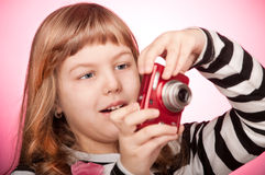 Girl with a camera Royalty Free Stock Photos