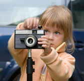 Girl at camera Royalty Free Stock Images