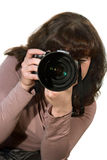 The girl with the camera. The girl - photographer with the camera on a white background Stock Photography