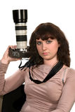 The girl with the camera. The girl - photographer with the camera on a white background Stock Images