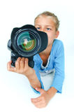 Girl with a camera big lens. Royalty Free Stock Image