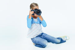 Girl with a camera big lens. Royalty Free Stock Photos