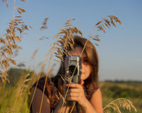 Girl with a camera Stock Photography