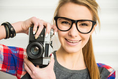 Girl with camera Royalty Free Stock Photography
