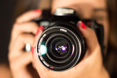 Girl with camera, closeup lens Royalty Free Stock Photography