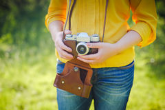 Girl with camera on country side Stock Photography