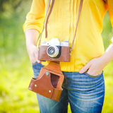 Girl with camera on country side Royalty Free Stock Photo