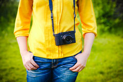 Girl with camera on country side Stock Photo
