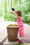 Girl with Camera Finding a Creative Perspective Royalty Free Stock Photos