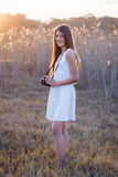 Girl with camera. Full length girl with camera royalty free stock photo