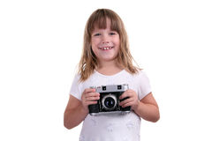 The girl with the camera in hands Stock Images