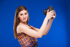 Girl with a camera in his hands Royalty Free Stock Photos