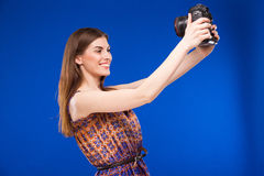 Girl with a camera in his hands Royalty Free Stock Image