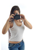 Girl with camera Stock Photography