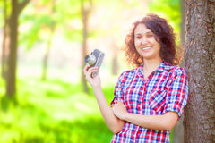 Girl with camera. Indian girl with camera in the park Royalty Free Stock Photography
