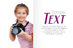 Girl with a camera looking for a white blank Stock Image