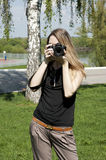 Girl with camera on nature Royalty Free Stock Images