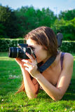 Girl with the camera in the park Stock Images