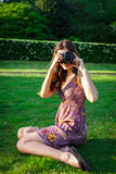 Girl with the camera in the park Royalty Free Stock Images
