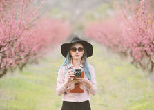 Girl with camera. Stock Photos