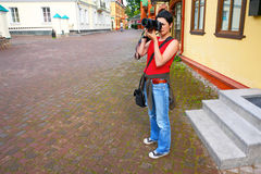 The girl with the camera. The photo on travel. Stock Images