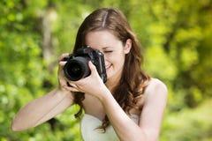 Girl with camera Royalty Free Stock Photos