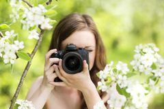 Girl with camera Royalty Free Stock Photos