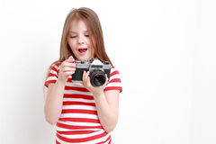 Girl and camera Royalty Free Stock Images
