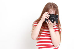 girl and camera Royalty Free Stock Photography