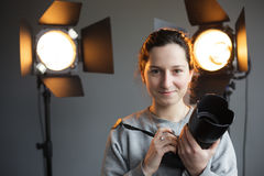 Girl with a camera in the studio on the background lighting. hip. Ster photographer royalty free stock photos
