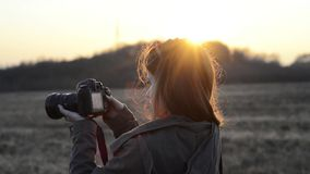 Girl with camera sunrise stock footage
