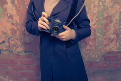 Girl with camera.Vintage times. Women holding retro photo camera outdoor. Stock Images