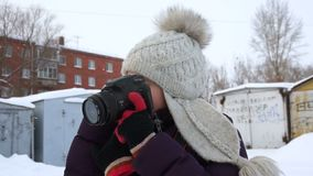 Girl with a camera on a winter day stock footage