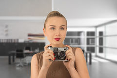Girl with a camera. Young girl holding an old camera Royalty Free Stock Images