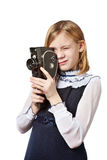 Girl cameraman filming with retro camera Stock Photo