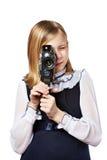 Girl cameraman filming with retro camera Stock Photo