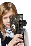 Girl cameraman filming with retro camera. Isolated Stock Photography