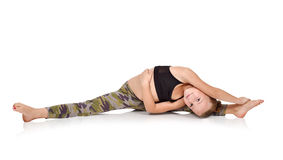 Girl in camo clothing doing yoga exercises Royalty Free Stock Image