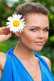 Girl with camomile Stock Images